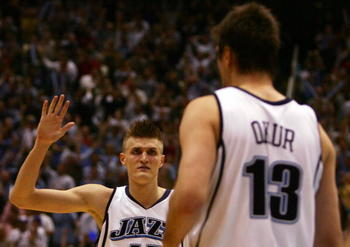 SALT LAKE CITY - MAY 03:  Andrei Kirilenko #47 of the Utah Jazz celebrates a Mehmet Okur #13 three pointer against the Houston Rockets in the fourth quarter during Game Six of the Western Conference Quarterfinals during the 2007 NBA Playoffs at the Energy