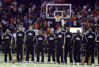 PHOENIX - OCTOBER 12:  The Utah Jazz stand attended for the National Anthem before the preseason NBA game against the Phoenix Suns at US Airways Center on October 12, 2010 in Phoenix, Arizona. NOTE TO USER: User expressly acknowledges and agrees that, by