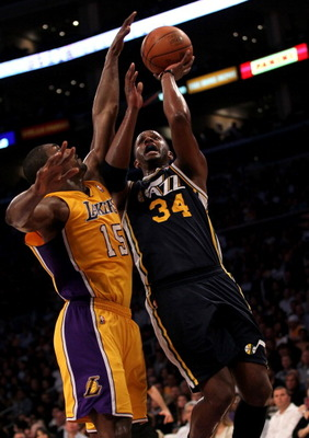 LOS ANGELES, CA - APRIL 05:  C.J. Miles #34 of the Utah Jazz goes up for a shot against Ron Artest #15 of the Los Angeles Lakers at Staples Center on April 5, 2011 in Los Angeles, California.  NOTE TO USER: User expressly acknowledges and agrees that, by
