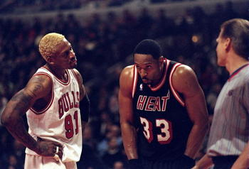 10 Mar 1998:  Center Alonzo Mourning of the Miami Heat (center) stands with forward Dennis Rodman of the Chicago Bulls (left) and referee Steve Javie during a game at the United Center in Chicago, Illinois.  The Bulls defeated the Heat 106-91. Mandatory C