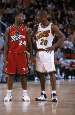 6 Dec 2000:  Gary Payton #20 of the Detroit Pistons talks with Mateen Cleaves #24 of the Seattle SuperSonics on the court during the game at Key Arena in Seattle, Washington. The Pistons defeated the SuperSonics 112-99.    NOTE TO USER: It is expressly un