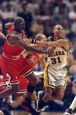 25 May, 1998:  Reggie Miller #31 pushes Michael Jordan #23 for the winning 3 pointer of game six during the NBA Eastern Conference Finals at the Market Square Arena in Indianapolis, Indiana.  The Pacers defeated the Bulls 96-94. Mandatory Credit: Vincent