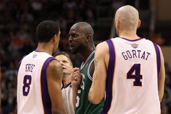 PHOENIX, AZ - JANUARY 28:  Kevin Garnett #5 of the Boston Celtics stares down Channing Frye #8 of the Phoenix Suns after Garnett was called for a technical foul during the NBA game at US Airways Center on January 28, 2011 in Phoenix, Arizona.  The Suns de