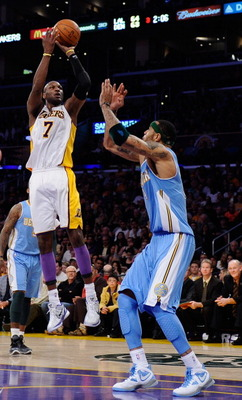 LOS ANGELES, CA - APRIL 03: Lamar Odom #7 of the  Los Angeles Lakers scores over Kenyon Martin #4 of the Denver Nuggets at Staples Center on April 3, 2011 in Los Angeles, California. NOTE TO USER: User expressly acknowledges and agrees that, by downloadin