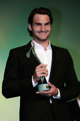 PARIS - MAY 31:  Roger Federer of Switzerland poses for a photo after being awarded singles champion of 2004 after the ninth day of the French Open at Roland Garros on May 31, 2005 in Paris, France.  (Photo by Clive Brunskill/Getty Images)