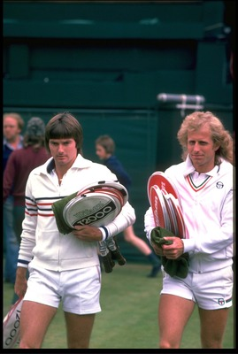 JUN 1978:  JIMMY CONNERS OF THE UNITED STATES AND VITAS GERULAITIS OF THE UNITED STATES ENTER CENTER COURT BEFORE THEIR MATCH AT THE 1978 WIMBLEDON CHAMPIONSHIPS.