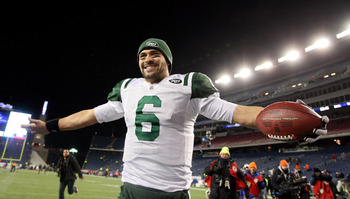 FOXBORO, MA - JANUARY 16:  Mark Sanchez #6 of the New York Jets celebrates after the Jets defeated the Patriots 28 to 21 in their 2011 AFC divisional playoff game at Gillette Stadium on January 16, 2011 in Foxboro, Massachusetts.  (Photo by Al Bello/Getty