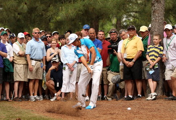 AUGUSTA, GA - APRIL 08:  Rickie Fowler hits his shot from the rough on the 11th hole during the second round of the 2011 Masters Tournament at Augusta National Golf Club on April 8, 2011 in Augusta, Georgia.  (Photo by Andrew Redington/Getty Images)