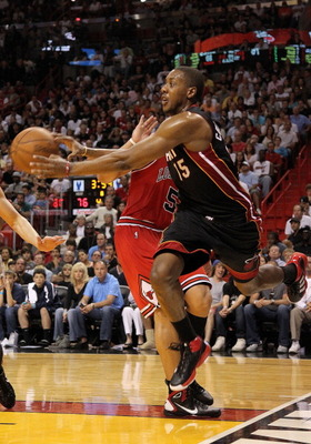 MIAMI, FL - MARCH 06: Mario Chalmers #15 of the Miami Heat chases down a loose ball during a game against the Chicago Bulls at American Airlines Arena on March 6, 2011 in Miami, Florida. NOTE TO USER: User expressly acknowledges and agrees that, by downlo