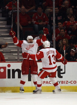 CHICAGO, IL - APRIL 10: Tomas Holmstrom #96 of the Detroit Red Wings celebrates a 2nd period goal with teammate Pavel Datsyuk #13 against the Chicago Blackhawks at the United Center on April 10, 2011 in Chicago, Illinois. (Photo by Jonathan Daniel/Getty I