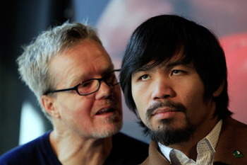NEW YORK, NY - FEBRUARY 14: (L) Trainer Freddie Roach talks to his boxer (R) Manny Pacquiao at a press conference to promote the fight with Shane Mosley at The Lighthouse at Chelsea Piers on February 14, 2011 in New York City.  (Photo by Chris Trotman/Get