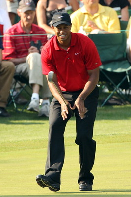AUGUSTA, GA - APRIL 10:  Tiger Woods reacts to a missed putt on the 16th green during the final round of the 2011 Masters Tournament at Augusta National Golf Club on April 10, 2011 in Augusta, Georgia.  (Photo by Andrew Redington/Getty Images)
