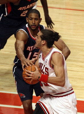 CHICAGO, IL - MARCH 11: Joakim Noah #13 of the Chicago Bulls drives against Al Horford #15 of the Atlanta Hawks at the United Center on March 11, 2011 in Chicago, Illinois. The Bulls defeated the Hawks 94-76. NOTE TO USER: User expressly acknowledges and