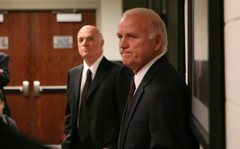 NEWARK, NJ - APRIL 26:  With New Jersey Devils team president Lou Lamoriello (L) by his side, head coach Jacques Lemaire (R) announces his retirement at the Prudential Center on April 26, 2010 in Newark, New Jersey.  (Photo by Bruce Bennett/Getty Images)