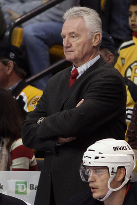 BOSTON - NOVEMBER 15:  Assistant coach Larry Robinson of the New Jersey Devils looks on from the bench in the first period against the Boston Bruins on November 15, 2010 at the TD Garden in Boston, Massachusetts.  (Photo by Elsa/Getty Images)