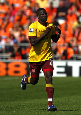 BLACKPOOL, ENGLAND - APRIL 10:  Emmanuel Eboue of Arsenal celebrates after scoring his goal during the Barclays Premier League match between Blackpool and Arsenal at Bloomfield Road on April 10, 2011 in Blackpool, England.  (Photo by Alex Livesey/Getty Im