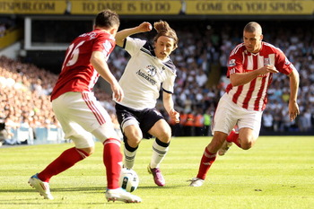 LONDON, ENGLAND - APRIL 09:  Luka Modric of Spurs is closed down by Salif Diao and Jonathan Walters of Stoke during the Barclays Premier League match between Tottenham Hotspur and Stoke City at White Hart Lane on April 9, 2011 in London, England.  (Photo