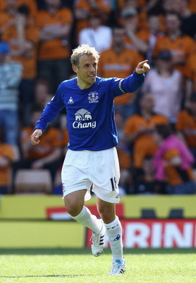 WOLVERHAMPTON, ENGLAND - APRIL 09:  Phil Neville of Everton celebrates scoring the second goal during the Barclays Premier League match between Wolverhampton Wanderers and Everton at Molineux on April 9, 2011 in Wolverhampton, England.  (Photo by Richard