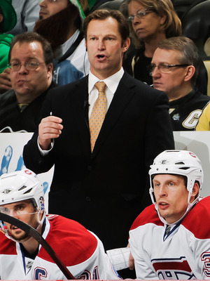 PITTSBURGH, PA - MARCH 12:  Assistant Coach Kirk Muller of the Montreal Canadiens and Head Coach Jacques Martin of the Montreal Canadiens watch their team play the Pittsburgh Penguins on March 12, 2011 at CONSOL Energy Center in Pittsburgh, Pennsylvania.