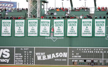 BOSTON - APRIL 20:  Boston Celtic Championship banners hung from the Green Monster during a tribute to Red before the start of the Boston Red Sox  versus the New York Yankees on April 20, 2007 at Fenway Park in Boston, Massachusetts.  (Photo by Elsa/Getty