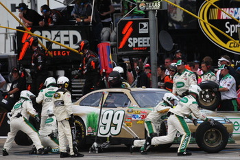 FORT WORTH, TX - APRIL 09:  Carl Edwards, driver of the #99 Scotts Ford, pits during the NASCAR Sprint Cup Series Samsung Mobile 500 at Texas Motor Speedway on April 9, 2011 in Fort Worth, Texas.  (Photo by Jonathan Ferrey/Getty Images for NASCAR)