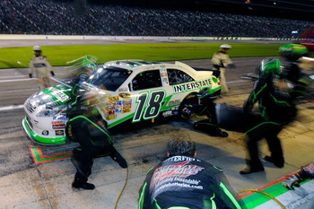 FORT WORTH, TX - APRIL 09:  Kyle Busch, driver of the #18 Interstate Batteries Toyota, makes a pit stop during the NASCAR Sprint Cup Series Samsung Mobile 500 at Texas Motor Speedway on April 9, 2011 in Fort Worth, Texas.  (Photo by Jared C. Tilton/Getty