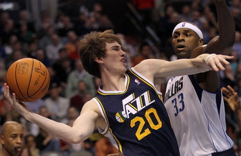 DALLAS, TX - FEBRUARY 23:  Forward Gordon Hayward #20 of the Utah Jazz passes the ball against Brendan Haywood #33 of the Dallas Mavericks at American Airlines Center on February 23, 2011 in Dallas, Texas.  NOTE TO USER: User expressly acknowledges and ag