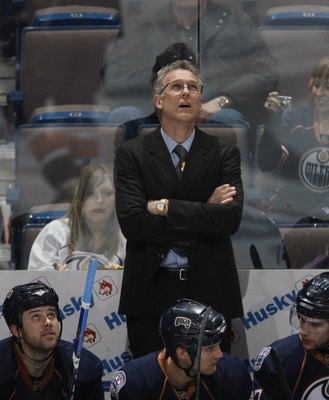 EDMONTON, CANADA - JANUARY 11: Head Coach Craig MacTavish of the Edmonton Oilers looks up at the scoreboard against the St. Louis Blues on January 11, 2009 at Rexall Place in Edmonton, Alberta, Canada. (Photo by Dale MacMillan/Getty Images)