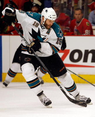CHICAGO - MAY 21:  Joe Thornton #19 of the San Jose Sharks moves the puck while taking on the Chicago Blackhawks in Game Three of the Western Conference Finals during the 2010 NHL Stanley Cup Playoffs at the United Center on May 21, 2010 in Chicago, Illin