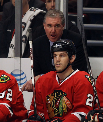 CHICAGO, IL - FEBRUARY 16: Assistant coach Mike Haviland of the Chicago Blackhawks, acting as head coach in place of Joel Quenneville, who is ill, watches the action with players including Tomas Kopecky #82 and Jake Dowell #28 against the Minnesota Wild a