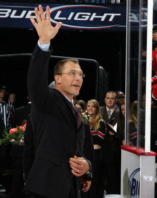 NEWARK, NJ - DECEMBER 07:  Former New Jersey Devils captain Scott Stevens waves to the crowd after a ceremony honoring his induction into the Hall of Fame before the game against the Washington Capitals at the Prudential Center December 7,  t 2007 in Newa