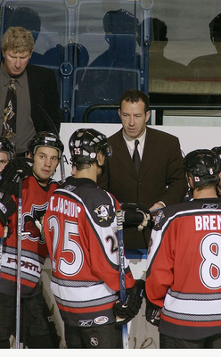 BRIDGEPORT, CT - OCTOBER 22:  Head coach Kevin Dineen of the Portland Pirates talks to players at the bench during a break in the game against the Bridgeport Sound Tigers at the Arena at Harbor Yard on October 22, 2005 in Bridgeport, Connecticut.  The Pir