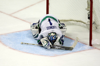 CHICAGO - MAY 07:  Goalie Roberto Luongo #1 of the Vancouver Canucks lies face down on the ice against the Chicago Blackhawks during Game Four of the Western Conference Semifinal Round of the 2009 Stanley Cup Playoffs on May 7, 2009 at the United Center i