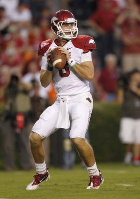 AUBURN - OCTOBER 16:  Quarterback Tyler Wilson #8 of the Arkansas Razorbacks drops back and looks downfield for receiver during the game against the Auburn Tigers at Jordan-Hare Stadium on October 16, 2010 in Auburn, Alabama.  The Tigers beat the Razorbac