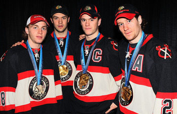 UNIONDALE, NY - MARCH 02:  (L-R) Chicago Blackhawks Olympic medal winners Patrick Kane of the Untited States, Brent Seabrook, Jonathan Toews, and Duncan Keith of Canada pose for a photo prior to playing the New York Islanders on March 2, 2010 at Nassau Co