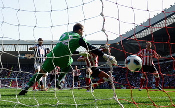 SUNDERLAND, ENGLAND - APRIL 09: Peter Odemwingie of West Bromwich Albion fires home his first half goal  during the Barclays Premier League match between Sunderland and West Bromwich Albion at The Stadium of Light on April 9, 2011 in Sunderland, England.