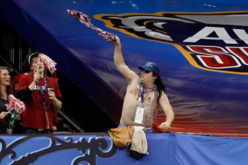 NEW ORLEANS, LA - JANUARY 04:  A fan cheers during the Allstate Sugar Bowl between the Arkansas Razorbacks and the Ohio State Buckeyes at the Louisiana Superdome on January 4, 2011 in New Orleans, Louisiana.  (Photo by Kevin C. Cox/Getty Images)