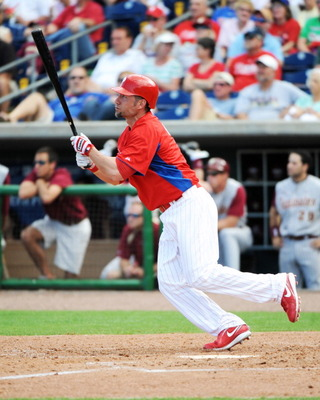CLEARWATER, FL - FEBRUARY 24:  Outfielder Ross Gload #7 of the Philadelphia Phillies bats against the Florida State Seminoles February 24, 2011 at Bright House Field in Clearwater, Florida.  (Photo by Al Messerschmidt/Getty Images)