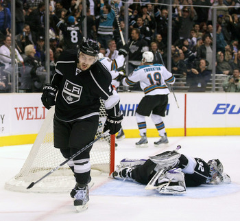 LOS ANGELES, CA - MARCH 24:  Drew Doughty #8 of the Los Angeles Kings reacts after Patrick Marleau #12 of the San Jose Sharks scored with less than five seconds left to tie the game 3-3 in the third period to force overtime during the NHL game at Staples