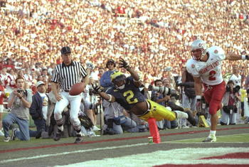 Charles Woodson #2 of Michigan makes a diving attempt to catcha a pass on Ray Jackson of Washington State during the Wolverines 21-16 win over Washington State in the 1998 Rose Bowl at the Rose Bowl in Pasadena, California.