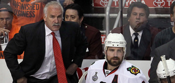 PHILADELPHIA - JUNE 09:  Head coach Joel Quenneville and Patrick Sharp #10 of the Chicago Blackhawks look on from the bench in Game Six of the 2010 NHL Stanley Cup Final against the Philadelphia Flyers at the Wachovia Center on June 9, 2010 in Philadelphi