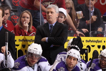 GLENDALE, AZ - JANUARY 22:  Head coach Terry Murray of the Los Angeles Kings watches from the bench during the NHL game against the Phoenix Coyotes at Jobing.com Arena on January 22, 2011 in Glendale, Arizona.  The Kings defeated the Coyotes 4-3. (Photo b