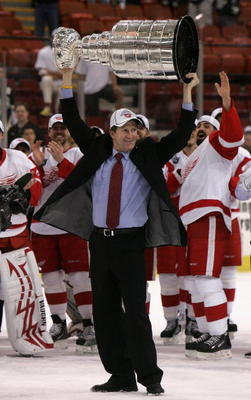 PITTSBURGH - JUNE 04:  Head coach Mike Babcock of the Detroit Red Wings celebrates with the Stanley Cup after defeating the Pittsburgh Penguins in game six of the 2008 NHL Stanley Cup Finals at Mellon Arena on June 4, 2008 in Pittsburgh. Pennsylvania. The