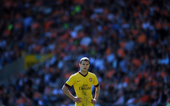 BLACKPOOL, ENGLAND - APRIL 10:  Jack Wilshere of Arsenal looks on during the Barclays Premier League match between Blackpool and Arsenal at Bloomfield Road on April 10, 2011 in Blackpool, England.  (Photo by Chris Brunskill/Getty Images)