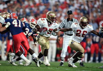 20 Nov 1999: Travis Minor #23 of the Florida State Seminoles runs with the ball during the game against the Florida Gators at the Ben HillGriffin Stadium in Gainsville, Florida. The Seminoles defeated the Gators 23-30.