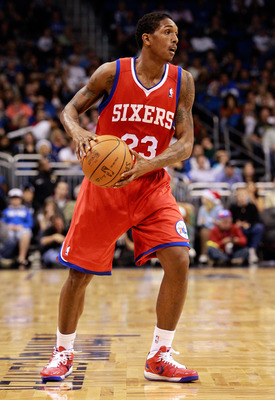 ORLANDO, FL - DECEMBER 18:  Louis Williams #23 of the Philadelphia 76ers looks to pass during the game against the Orlando Magic at Amway Arena on December 18, 2010 in Orlando, Florida.  NOTE TO USER: User expressly acknowledges and agrees that, by downlo