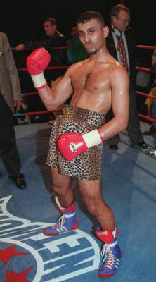 21 JAN 1995:  WBC INTERNATIONAL SUPER BANTAMWEIGHT CHAMPION PRINCE NASEEM HAMED OF GREAT BRITAIN STRIKES A FAMILIAR POSE AFTER HE STOPPED CHALLENGER ARMANDO CASTRO OF MEXICO IN THE FOURTH ROUND OF THEIR TITLE FIGHT IN GLASGOW.  Mandatory Credit: Phil Cole