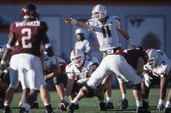 1 Dec 2001:  Quarterback Ken Dorsey #11 of the Miami Hurricanes calls a play as his teammate Brett Romberg #66 prepares to snap the ball during the NCAA game against the Virginia Tech Hokies at Lane Stadium in Blacksburg, Virginia.  Miami defeated Virgini