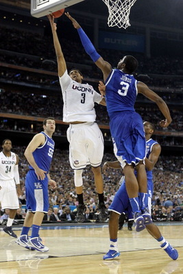 HOUSTON, TX - APRIL 02:  Jeremy Lamb #3 of the Connecticut Huskies goes to the hoop against Terrence Jones #3 of the Kentucky Wildcats during the National Semifinal game of the 2011 NCAA Division I Men's Basketball Championship at Reliant Stadium on April