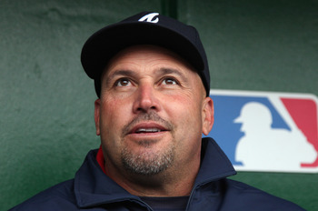 WASHINGTON, DC - MARCH 31:  Manager Fredi Gonzalez of the Atlanta Braves talks with the media in the dugout prior to their opening day game against the Washington Nationals at Nationals Park on March 31, 2011 in Washington, DC.  (Photo by Rob Carr/Getty I